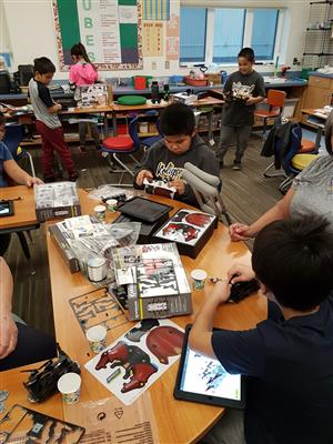 classroom with students building robot kits
