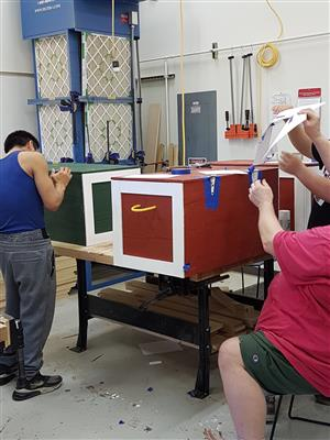 shop class working on storage chest
