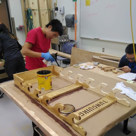 A student works on a project in the wood shop.