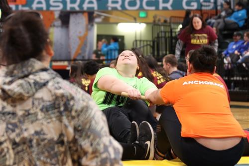 Monica Ishnook of Koliganek competes against an Anchorage student in Eskimo Stick Pull